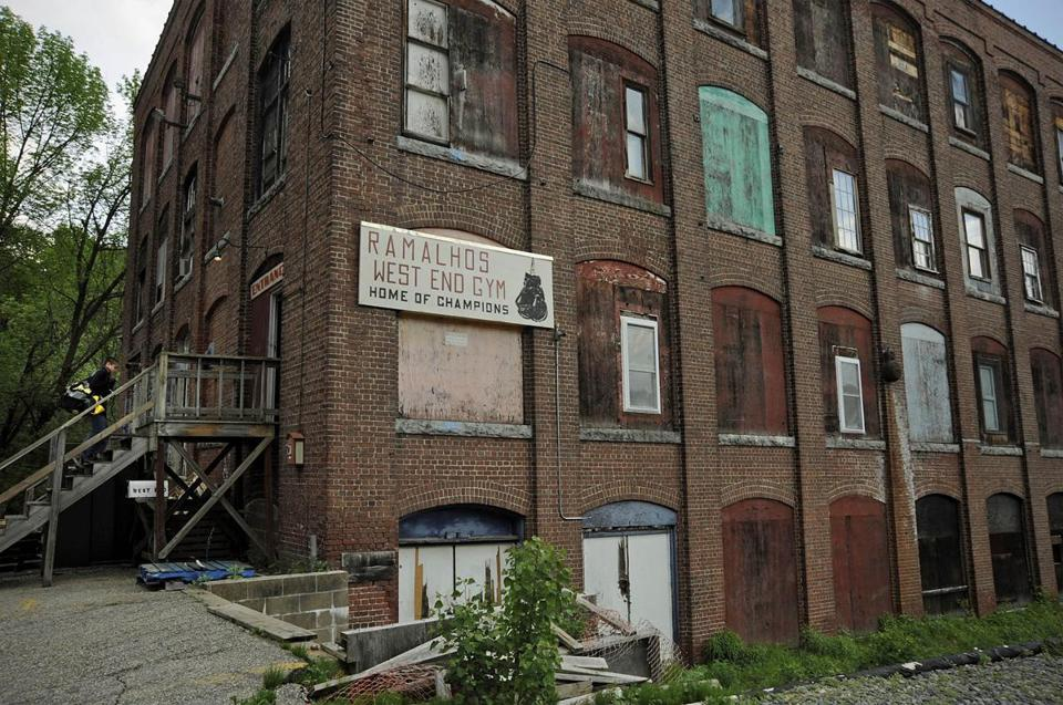 Cities like Lowell are dotted with dilapidated industrial buildings that have been abandoned, or nearly so, for years.
